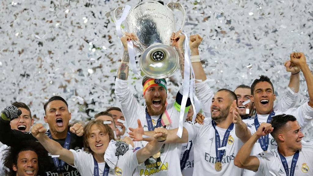 Real Madrid's Sergio Ramos celebrates with the trophy after the Champ